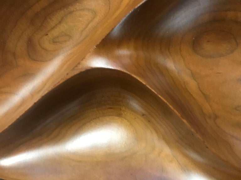 An exquisitely carved compartmental freeform bowl by Emil Milan (1922-1985), executed in richly grained walnut. Rich patina throughout. Signed to the underside,
