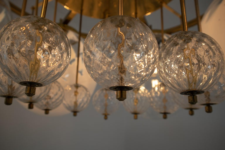 European Large Midcentury Hotel Chandelier, in Brass and Decorated Art Glass For Sale