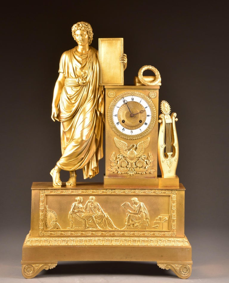This fire-gilt bronze pendulum is a beautiful piece of design and very fine relief decorations in neoclassical style and large three-dimensional sculptures.  (71 cm)   This clock comes with a winding key and rope pendulum.  Movement has recently