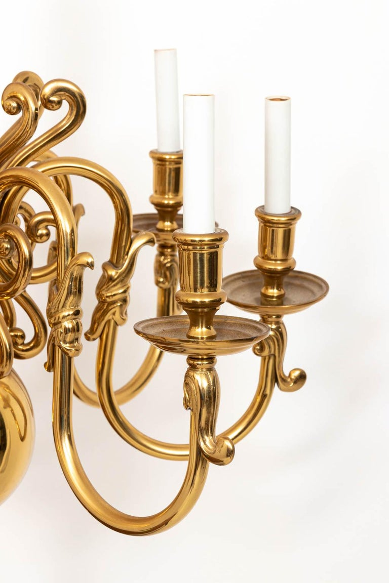 Large solid brass chandelier with eight arms in the Hollywood Regency style, circa 1960s. The piece is heavy for size. Working condition. Measurement without chain. Please note of wear consistent with age and use. Made in the United States.