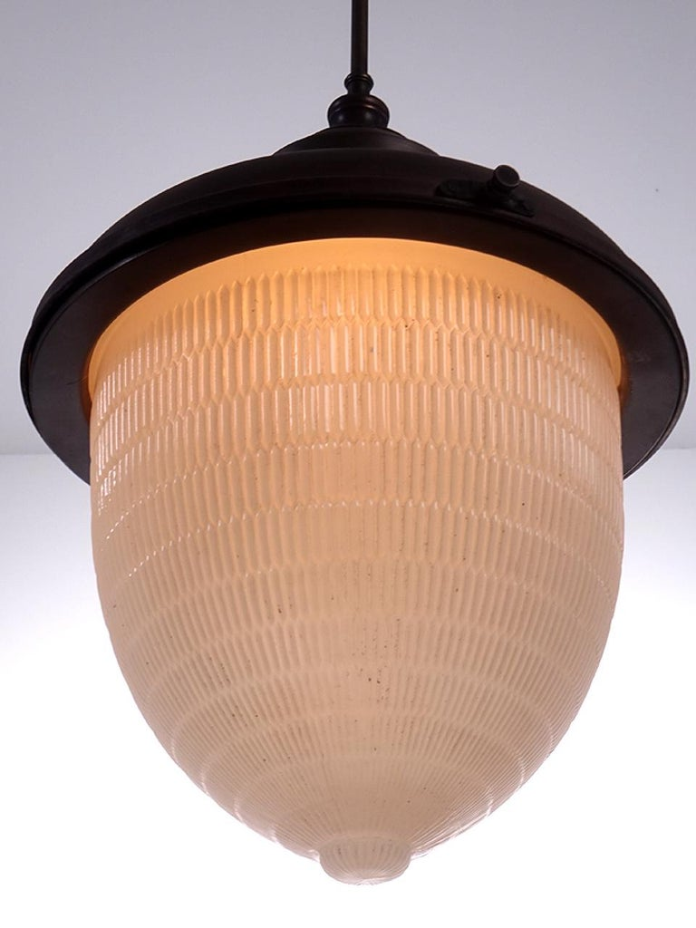 At 18 inches tall plus pipe this is an impressive lamp. The lamp definitely has an acorn look. The glass is a heavy cast clam broth color with an elongated honeycomb pattern.