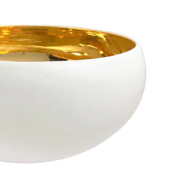 Large alabaster glaze curved ceramic bowl with 22-karat gold lustre interior by Sandi Fellman, 2018.   Veteran photographer Sandi Fellman's ceramic vessels are an exploration of a new medium. The forms, palettes, and sensuality of her photos can
