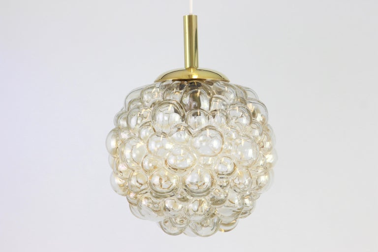 A large round with light smoke tone bubble glass pendant designed by Helena Tynell for Limburg, manufactured in Germany, circa 1970s  Sockets: It needs 1 x E27 standard bulb. Measure: Diameter 30 cm // 12 inches Height (adjustable) 80 cm // 31.5