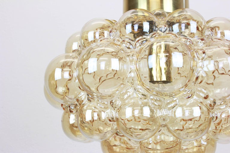 A large round smoke tone bubble glass pendant designed by Helena Tynell for Limburg, manufactured in Germany, circa 1970s.  Sockets: needs 1 x E27 standard bulb with 100W max each and compatible with the US/UK/ etc standards Drop rod can be