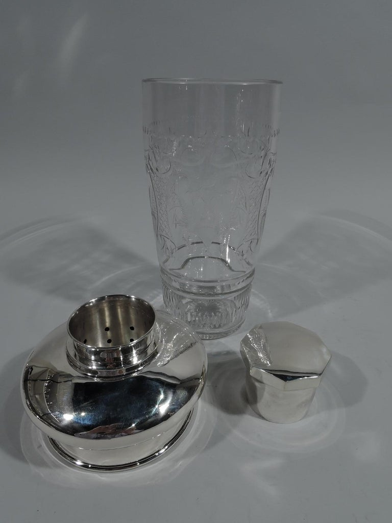 Large American Modern sterling silver and glass cocktail Shaker. Made by Erskine V. Van Houten in White Plains, New York, circa 1940. Glass cup with straight and tapering sides with etched stylized ornament: strapwork cartouches alternating with