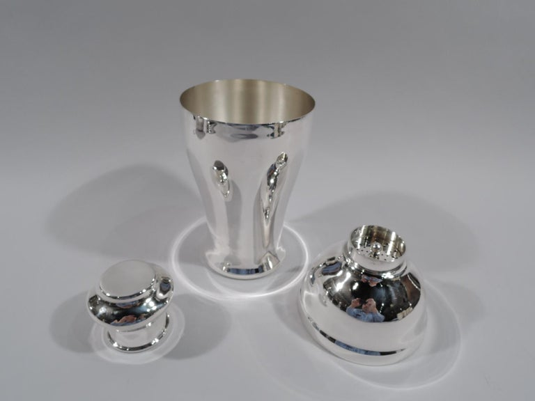 """American Modern sterling silver cocktail shaker, circa 1920. Curved and tapering bowl, domed top, and short neck with built-in strainer and bellied snug-fitting cap. Large and voluptuous form. A two-handed model. Marked """"Sterling / 2238"""". Weight: 15"""