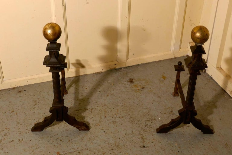 """A very large and heavy pair of French 19th century brass and iron andirons or fire dogs  This is a very heavy and large pair of andirons and they are made of twisted cast iron with a large brass knob on the top The andirons are 26"""" high, 16"""" long"""