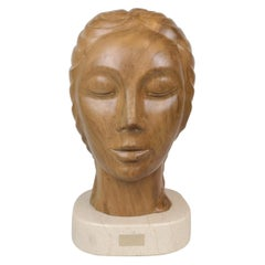 Large and Heavy Sculpture of a Female Face in Mahogany