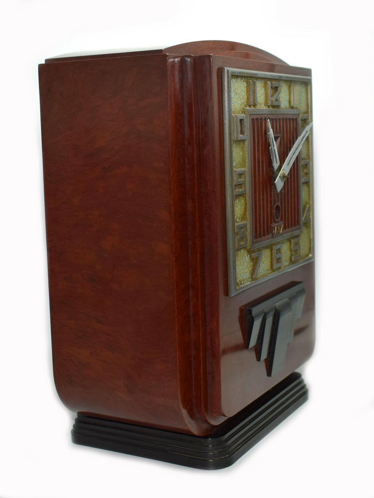 This is the daddy of true 1930s Art Deco clocks. Made in France by the very collectable JAZ company, this clock screams everything about the Deco era we all love and admire, streamline, Industrial and modernist. The casing is a red mottled color,
