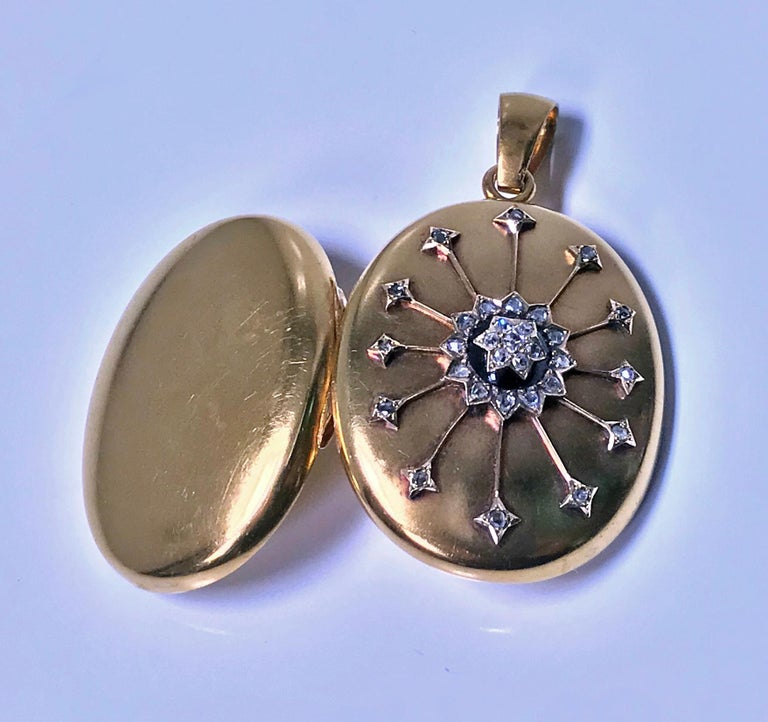 Antique 18K Diamond large Pendant Locket, C.1860. The front with diamond star set centre surmounted on black onyx and diamond surround with applied gold diamond set rays extending outwards, thirty one mixed old mine cut and rose cut diamonds, all on