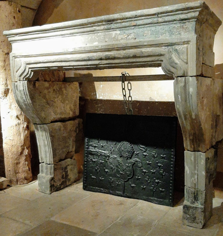 Stunning antique limestone / sandstone / sand-lime fireplace, from the 18th century France Baroque, where you can still see the old patina residues. 