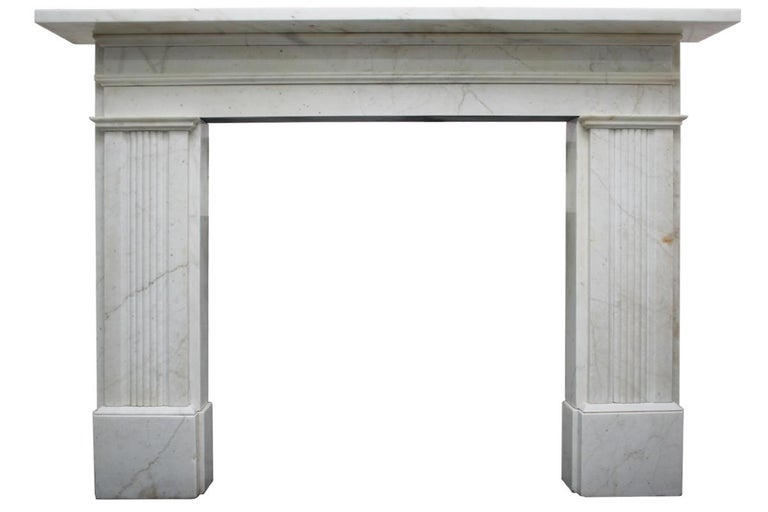 Large antique 19th century Victorian white marble fireplace with reeded legs and sectioned frieze. Circa 1850. Removed from a fine property in Liverpool.   Pictured with a rare large antique Victorian arched fireplace grate of simple form with