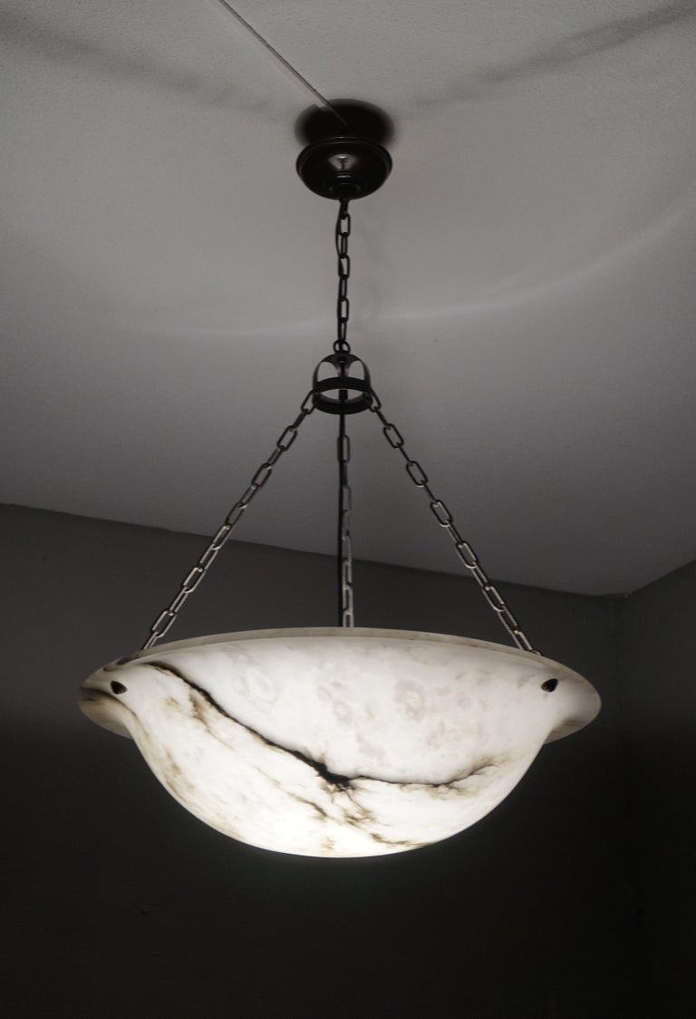 Top class chandelier with a stunning and rare size alabaster shade.  Thanks to its large size and truly excellent condition this alabaster chandelier will light up both your days and evenings. It is black and white from top to bottom and the