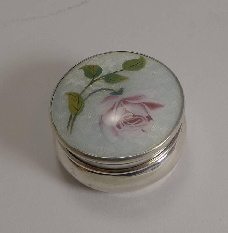 Pretty as a picture, this antique pill box is beautifully shaped and topped with the most attractive guilloche enamel decoration incorporating a romantic hand painted pink rose.