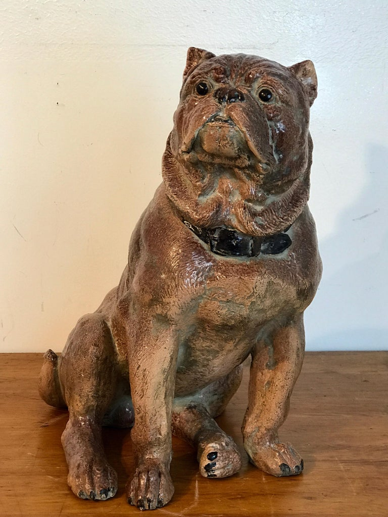 Large antique English stoneware figure of a seated pug, realistically modeled, with great detailed face, complete with collar. Painted and glazed, resembling terracotta but heavier and glazed.