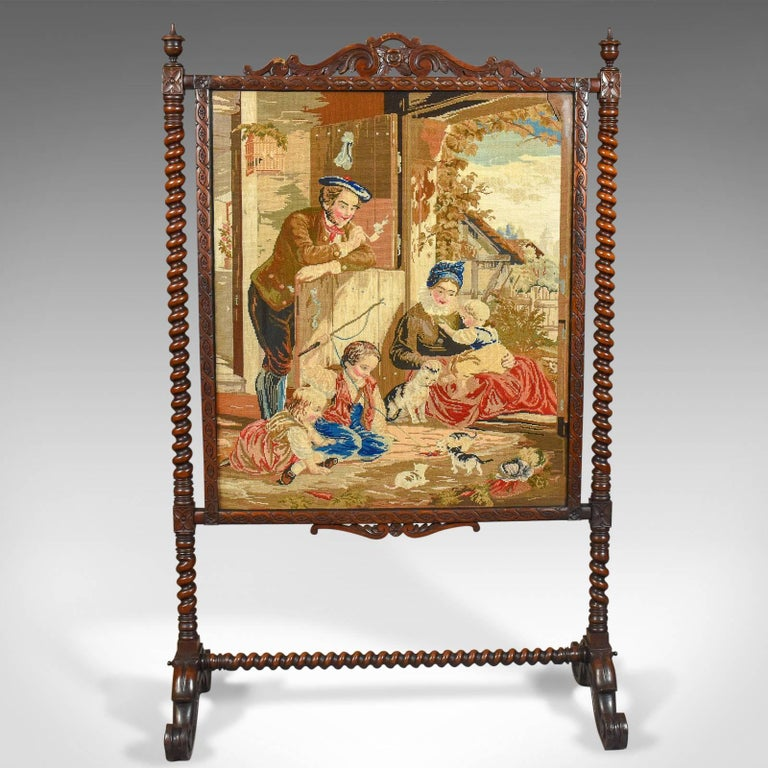 This is a large antique fire screen with needlepoint tapestry panel in a walnut frame, dating to circa 1850.  Superb needlepoint tapestry panel Retaining good color and detail, noticeably in the clouds A farmhouse scene of a family watching
