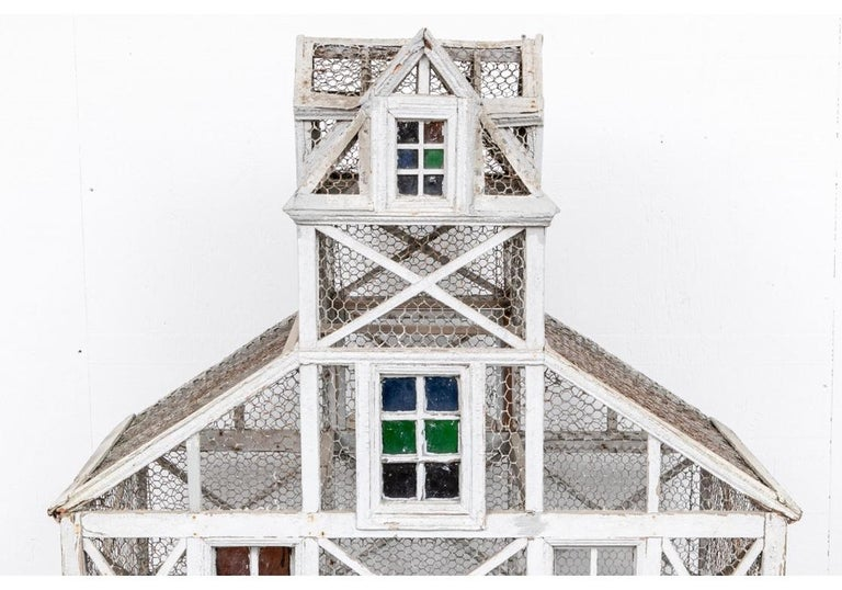A notable antique Dovecote with a very Architectural presence having good size and in all original condition. Wood painted in pale gray with a cupola at the top with four dormers. Sloping roofs on the sides over four levels with X frames. With