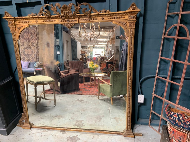 19th century Baroque Style gilt mirror dating to around the 1860s. This mirror could use a little restoration mainly along the frame. The glass has some wear, but also looks incredible as is, the imperfections add so much character to this gorgeous