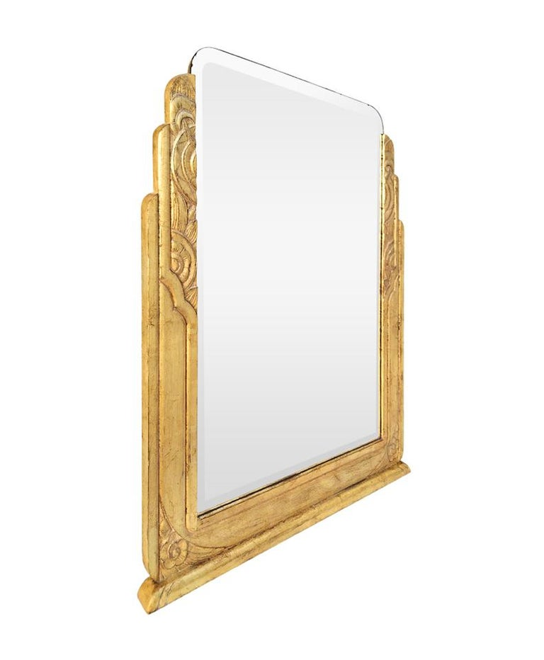 Large antique giltwood mirror, carved wood Art Deco style. Re-gilding to the patinated leaf on carved oak wood (frame width: 10 cm / 3.93 in.). Antique beveled glass mirror. Antique wood back.