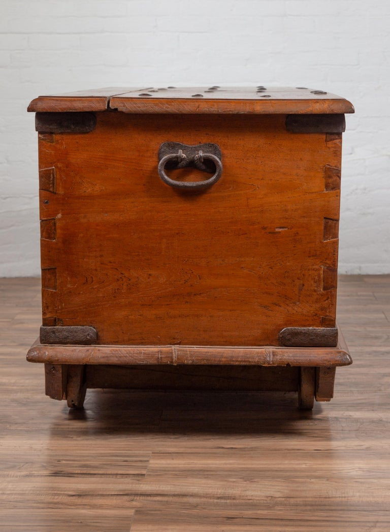 Large Antique Javanese Teak Wood Blanket Chest on Wheels with Iron Nailheads For Sale 8