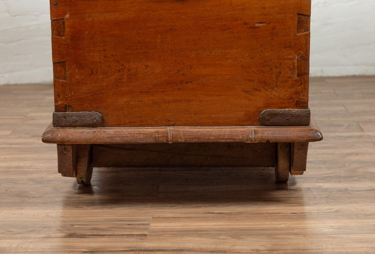 Large Antique Javanese Teak Wood Blanket Chest on Wheels with Iron Nailheads For Sale 9