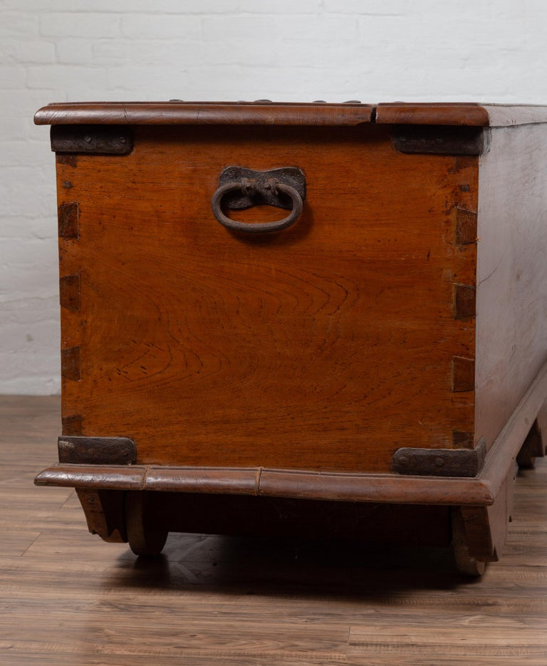 Large Antique Javanese Teak Wood Blanket Chest on Wheels with Iron Nailheads For Sale 11
