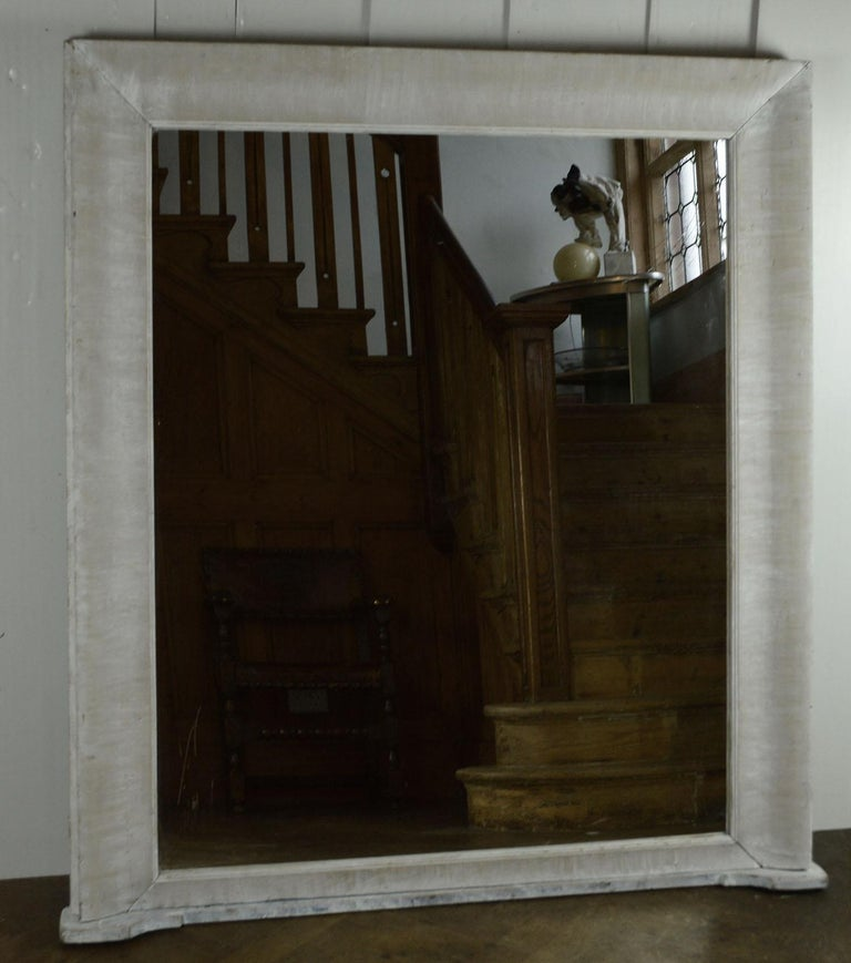 Super limed pine mirror.  Wonderful simple lines.   With its unusual flat base it is ideal for over a fireplace or a console table.  It has been recently limed.  The mirror plate is new. It has been slightly distressed particularly in the