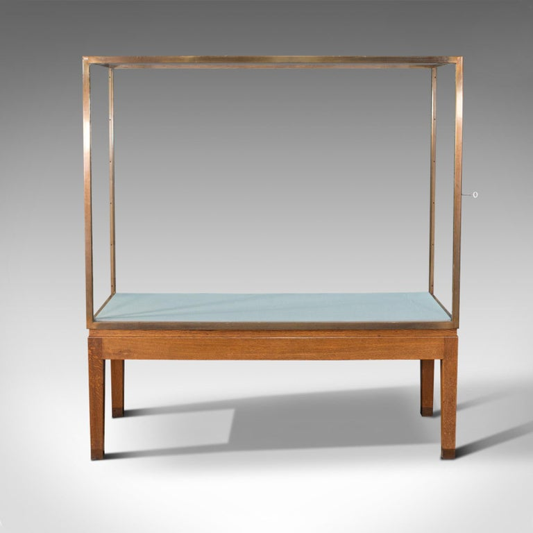 This is a large antique museum showcase. An English, bronze over oak display cabinet or case, dating to the Edwardian period, circa 1910.  Of superior proportion and clarity Displaying a desirable aged patina and in good order Polished bronze