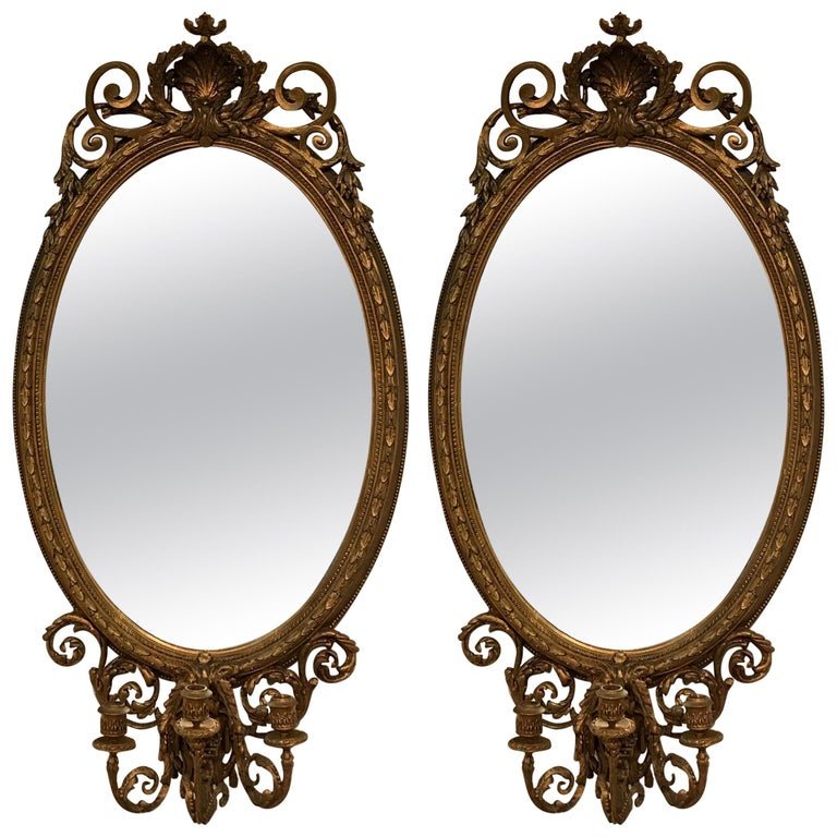 Large Antique Pair Of Oval Gilt Girondole Mirrors For Sale