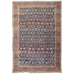 Large Antique Persian Bidjar Rug on a Blue Background and All-Over Pattern