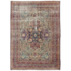 Large Antique Persian Lavar Kerman Rug with Blooming Central Medallion