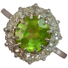 Large Antique Platinum Peridot and Old Cut Diamond Cluster Ring