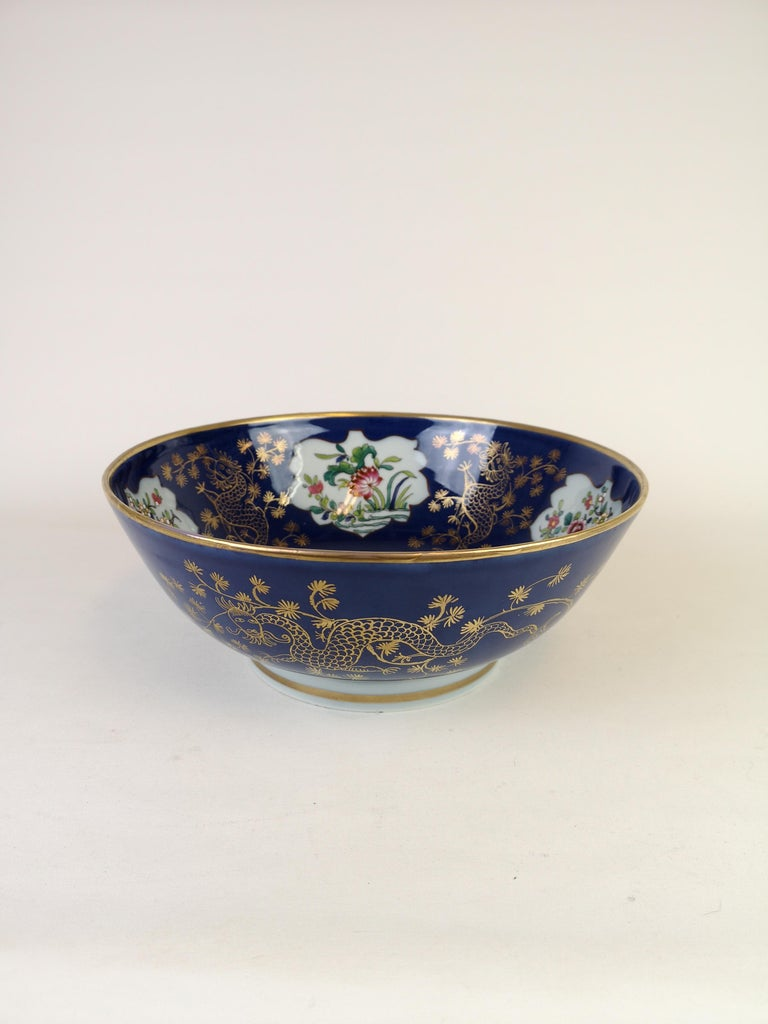 This bowl is made with high quality. It was made by the best porcelain makers and painters in France to imitate the chines porcelain. This blue bowl is made with golden paint and incredible fine art work inside of the bowl. Made in the late 1900 or