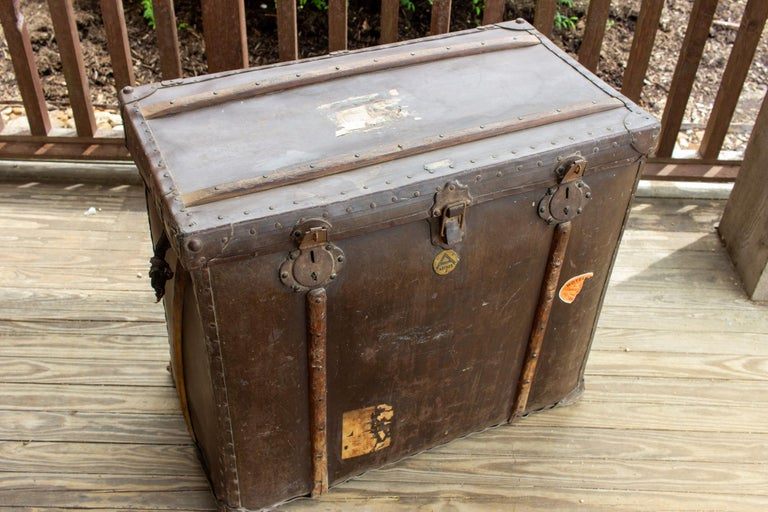 This large, antique leather trunk is marked