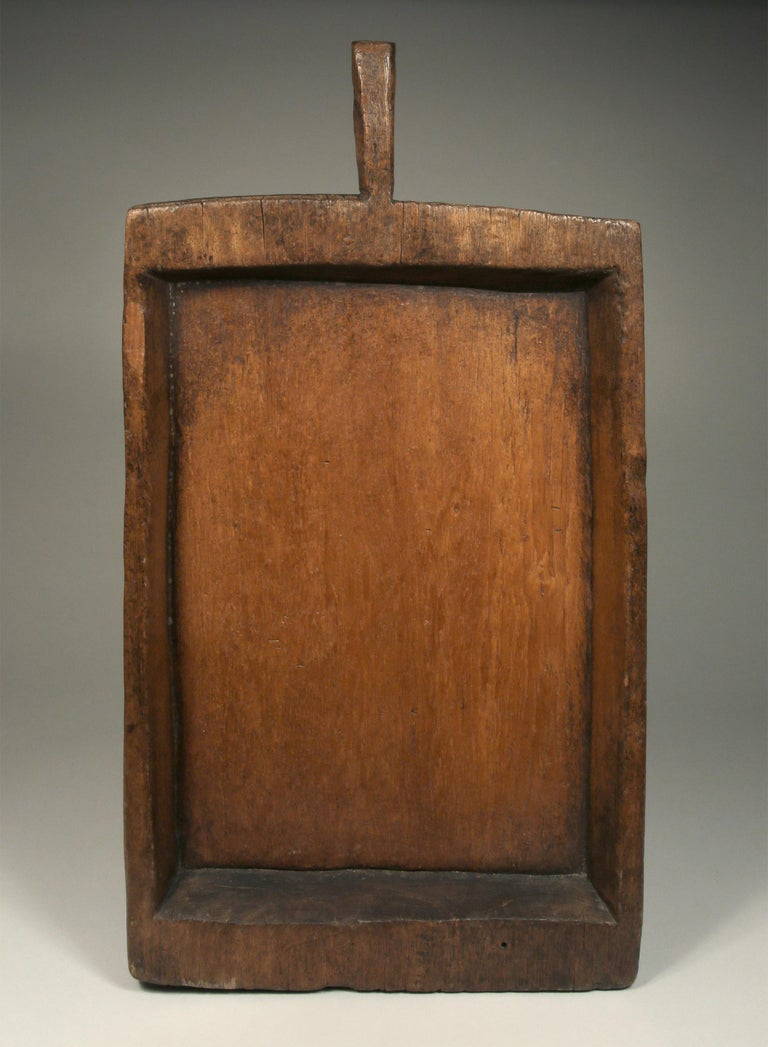 Large antique rectangular sticky rice tray (Kraboam) from Northern Thailand, early to mid-20th century.  Carved from one piece of dense teak wood including its handle. Sticky rice trays were used to release the steam from cooked sticky rice