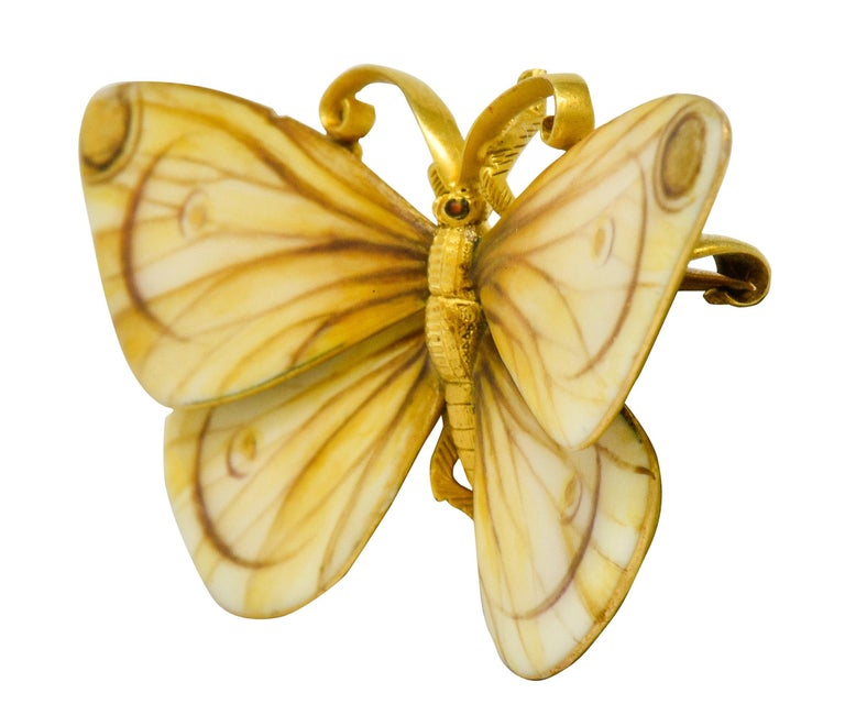 Brooch is designed as a butterfly with spread wings coated by matte enamel, sepia to yellow in color with gold accents  Enamel is incredibly illustrative with delicate wing veining and gradient color; exhibits virtually no loss  With a highly