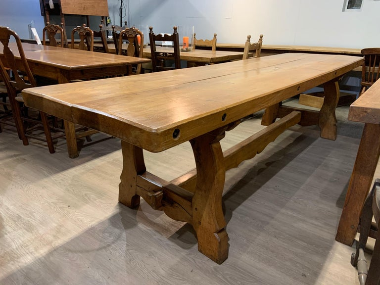 """Large antique elm twin plank Alpine trestle table with 3"""" thick top and sits on end trestles with centre stretcher."""