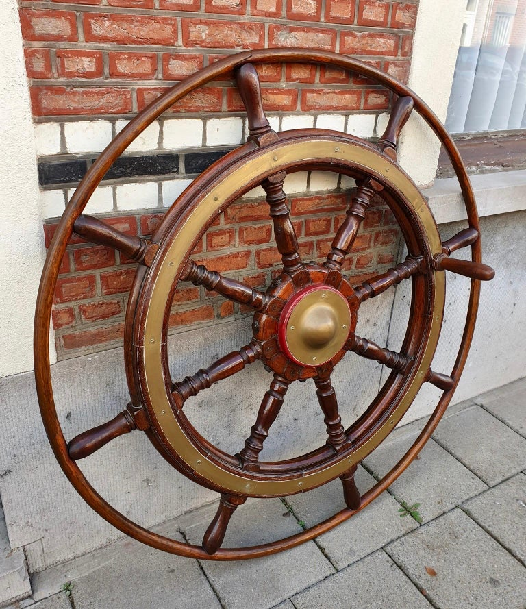 This is a superb and very large antique Victorian mahogany and brass set ships wheel, circa 1880-1900 in date. This exceptional nautical collectable features eight elegant trunking cylindrical spokes ending in handles, and made from beautiful