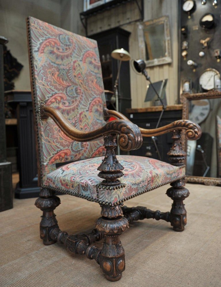 Large French armchair in solid carved oak newly reupholstered with nails all in excellent condition.
