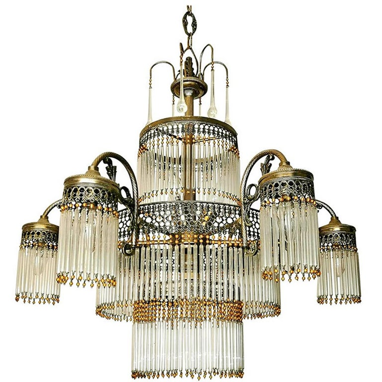 Fabulous large Art Deco and Art Nouveau chandelier in clear glass and amber beads early 20th century. Measures: Diameter: 28 in/ 70 cm Height: 49 in (chain 13.4 in)/ 124 cm (chain 34 cm) Weight: 20 lb/ 9 Kg 10 light bulbs ( 9xE14 +1x E27) Good