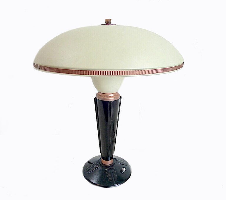 Designed by Eileen Gray for the French Jumo company and dating to the 1930s this very stylish lamp is made from two primary components which are bakelite and metal. Superb mushroom shape enameled metal shade with copper accents and finial. Condition
