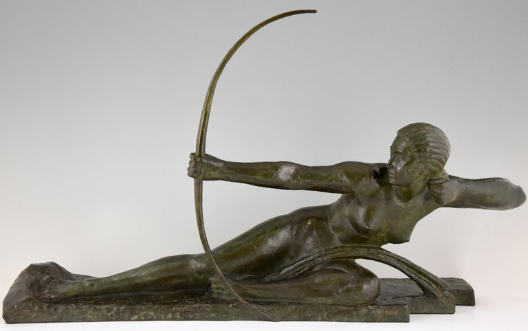 Impressive Art Deco bronze sculpture of a nude with bow picturing Penthesilia, queen of the Amazons. Signed by the famous French sculptor Marcel André Bouraine 1886-1948. Beautiful dark green patina. This spectacular sculpture has the Susse Freres