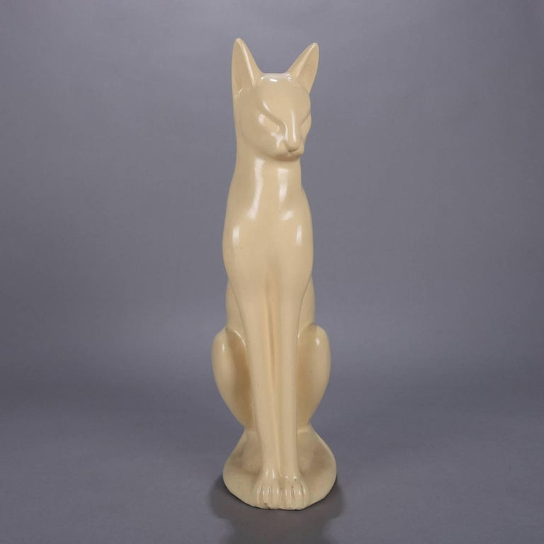Large Art Deco figural ceramic sculpture of seated Siamese cat in cream glaze, circa 1930.