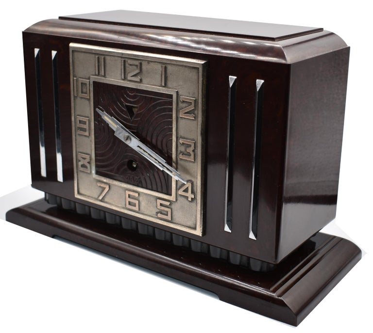 This is the daddy of true 1930s Art Deco clocks. Made in France by the very collectable JAZ company, this clock screams everything about the deco era we all love and admire, streamline, Industrial and modernist. The casing is a mottled deep red