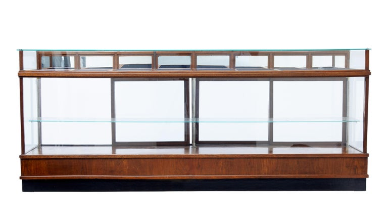 Large impressive haberdashery shop display, circa 1930.  Glazed front, sides and top. Presented in a teak frame standing on a ebonised plinth.  Single glazed shelf held in place by three chrome supports, the shelf is accessible by four-sliding