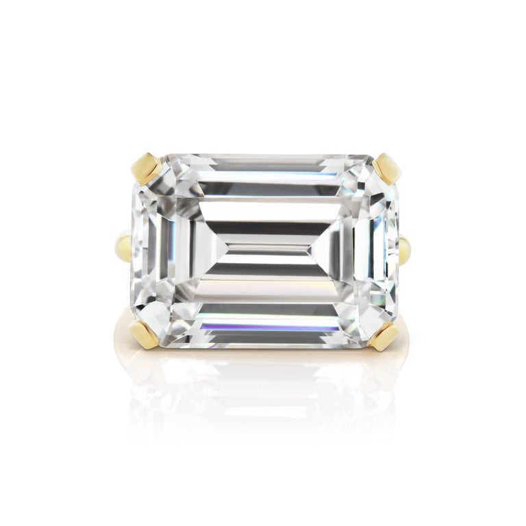 Magnificent  Costume Jewelry Faux Emerald Cut 15 Carat Diamond  Contemporary Modern Vermeil Setting Ring. This Newly Designed Ring Measure 3/4 inch across, half an inch wide and sits 1/4 inch on the finger. Chic Bold Impressive. Free sizing.