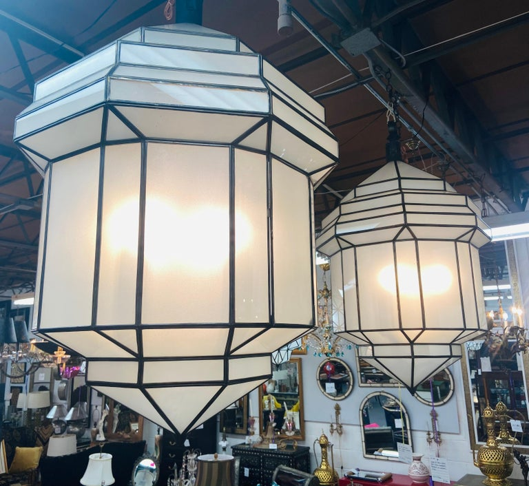 Large Art Deco white milk glass handmade chandelier, pendant, lantern, a pair  A gorgeous handcrafted, having individual panes, pair of large Art Deco hanging lanterns or ceiling fixtures featuring sandblasted frosted milky glass and patinated
