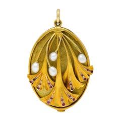 Large Art Nouveau Pearl Ruby Diamond 18 Karat Two-Tone Ginkgo Mirror Locket Pend