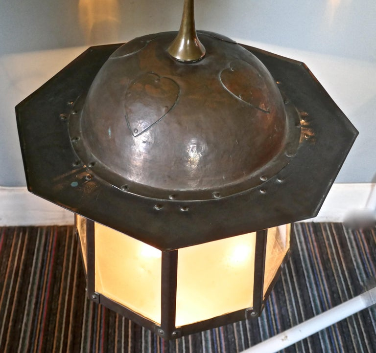 LargeArts & Crafts beaten copper hall lantern ceiling light  This large copper hall lantern is of classic Arts & Crafts design, it has glass panels set into each of its 8 sides above each there is an oval amber jewelled glass, which lights when