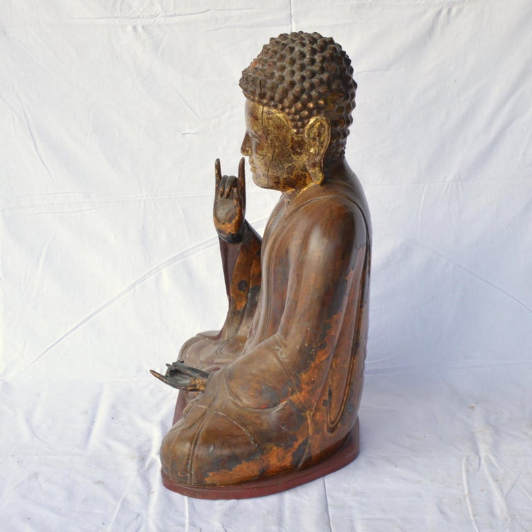 Wood Large Asian Patinated and Gilt Buddha Sculpture For Sale